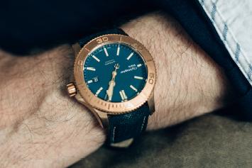 a closeup of a Christopher Ward watch's bezel